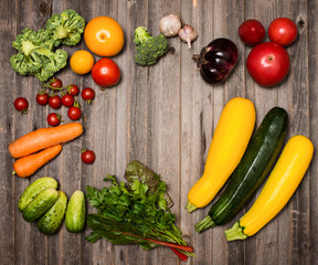 Fresh ingredients for cooking on rustic weathered wood background