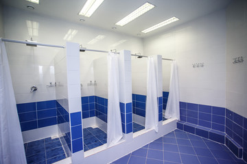 Shower room with cabins in a gym