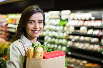 woman holding a grocery bag in organic section