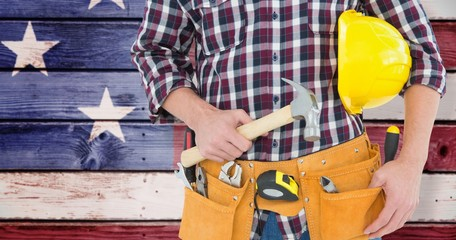 Composite image of repairman with hard hat and hammer