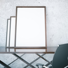 Blank picture frames on table