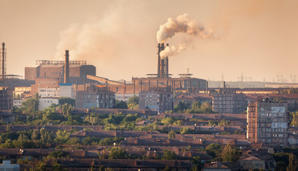Steel mill, Metallurgy plant at sunset. Heavy industry factory. Steel factory with smog. Pipes with smoke. Metallurgical plant. steel, iron works. Ecology problems, atmospheric pollutants. Buildings