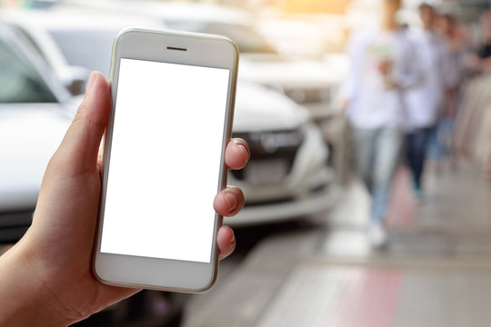 Woman hand holding smartphone isolated white screen with car on road  background