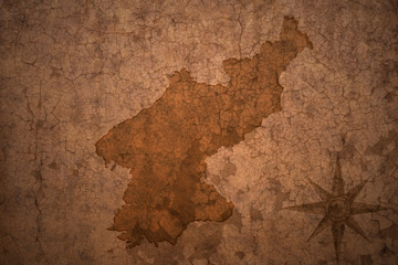north korea map on vintage crack paper background