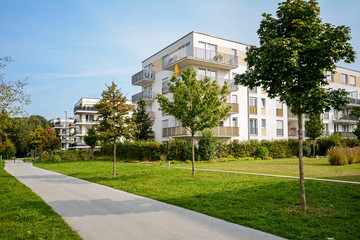 New apartment building - modern residential development in a green urban settlement