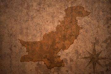 pakistan map on vintage crack paper background