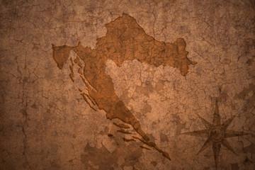 croatia map on vintage crack paper background