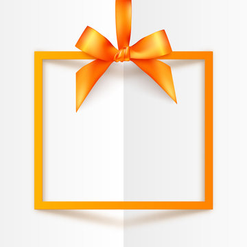 Orange vector gift box frame with silky bow and ribbon on white folded paper background