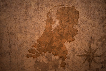 netherlands map on vintage crack paper background