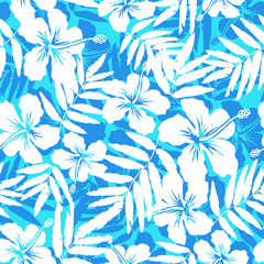 Blue and white tropical flowers silhouettes vector seamless pattern