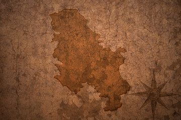 serbia map on vintage crack paper background