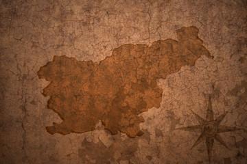 slovenia map on vintage crack paper background