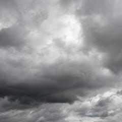 Sunshine through gray sky, rain.