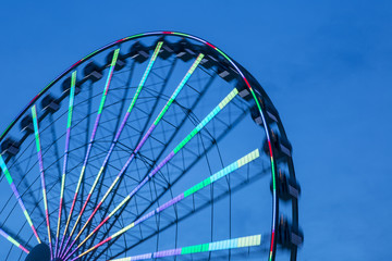 Turning Low Angle View Of Silhouette Ferris Wheel At Sunset
