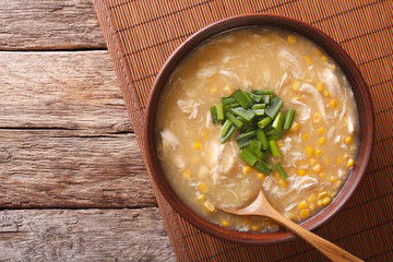 Chinese corn and chicken soup in a bowl close-up. horizontal top view