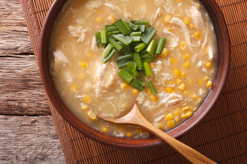 Chinese food: corn soup with chicken and onions close-up. horizontal top view