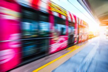 red speeding tram against sunbeam,hong kong,china.