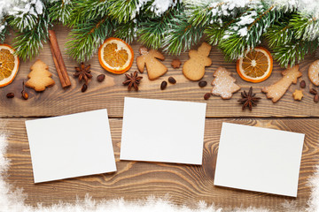 Christmas photo frames, tree, spices and cookies