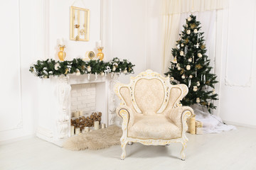 decorated chrismas room with a tree,fireplace, easy chair
