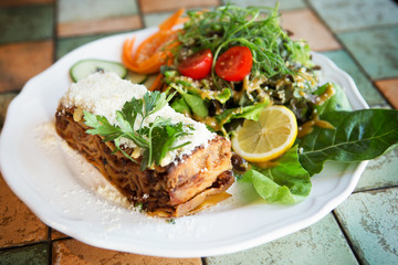 Vegetarian lasagna served with delicious salad