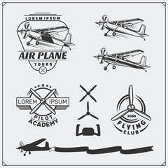 Airplane Club labels, emblems, badges and design elements. Vector monochrome illustration. Vintage style.