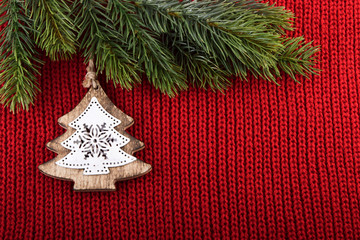 Christmas tree traditional decoration on red wool background.
