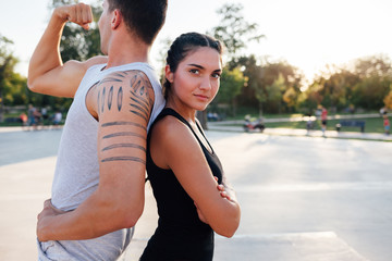 Athletic woman and man posing