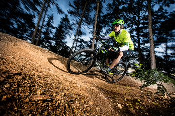 Cyclist riding mountain bike.