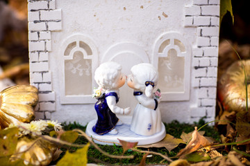 Figure of kissing couple in autumn park