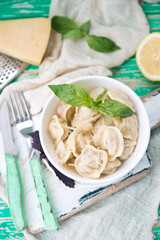 Plate of boiled pelmeni with cheese