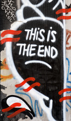 Graffiti, This is the End,  on disused shop door
