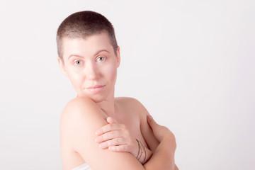Portrait of bald nude girl