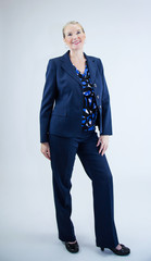 Business Woman Standing Looking at Camera Smiling