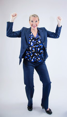 Business Woman Smiling with Hands In Air