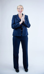 Business Woman Smiling with Hands Clasp Together