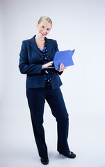 Business Woman Holding Tablet Looking at Camera Smiling
