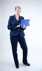 Business Woman Looking at Tablet with Surprise Look