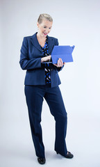 Business Woman Looking at Tablet with Smile