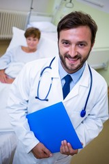 Smiling doctor holding a medical report