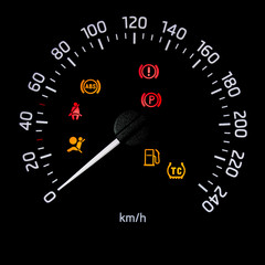 Speedometer dial with needle showing zero speed and diagnostic icons isolated on black background