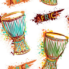 Seamless pattern with african drum tam tam and splashes in watercolor style. Colorful hand drawn vector illustration