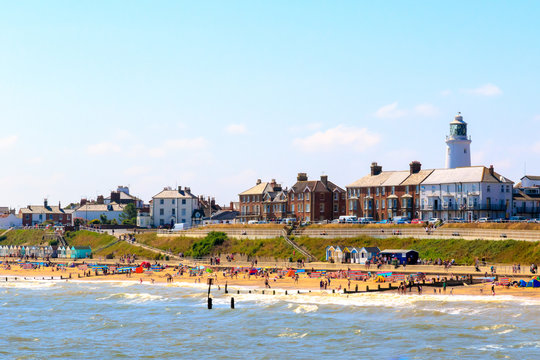 Seaside cottages and lighthouse at Southwold beach in UK