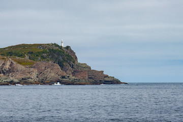 White Lighthouse on Cliffs in Newfoundland