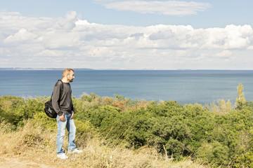 Beautiful sea landscape. A man looks at the sea.