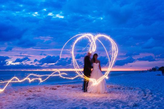 wedding evening sparkler photo