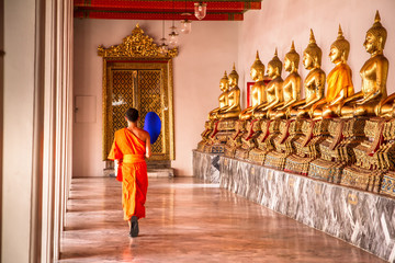 Bangkok, Thailand - May, 19, 2013 : Buddhist monks walking among