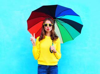 Fashion pretty cool woman holding colorful umbrella in autumn da