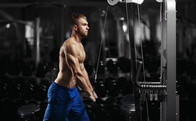 Bodybuilder man in the gym