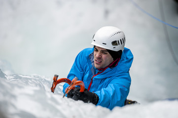 Man lead climbing an ice fall in Simplon Pass, Valais, Switzerland.