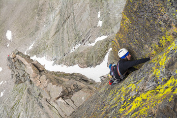 A man rock climbing in Rocky Mountain National Park, Estes Park, Colorado.